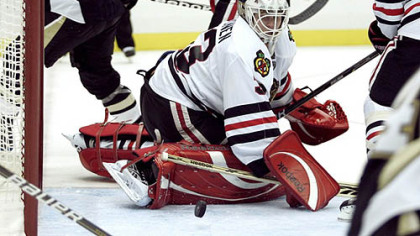 Blackhawks goaltender Hannu Toivonen makes a save.