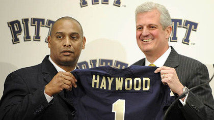 New Pitt head coach Michael Haywood poses with athletic director Steve Pederson during a press conference Thursday.