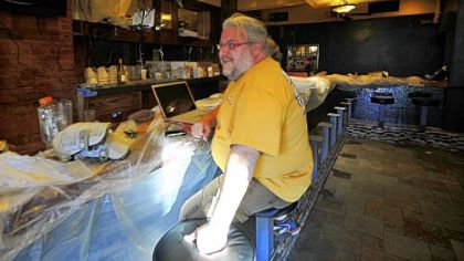 Rodney Swartz, one of five partners who renovated the Shiloh Inn, sits in the bar area of the restaurant.