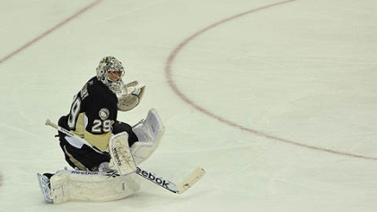 Penguins goaltender Marc-Andre Fleury stops a puck during the first period.