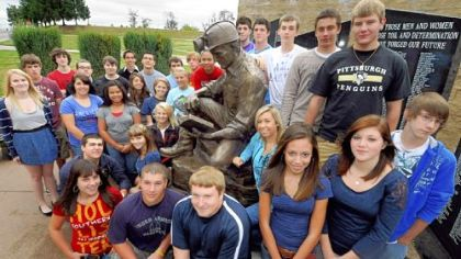 Ray VanSickle's Spanish 3 and 4 classes at Bethlehem-Center High School have written letters in Spanish to families of the miners trapped deep in a mine in Chile. Ian Sowers' (front, middle) father, Brad, is a coal miner. They are gathered around a coal miner statue outside the school.
