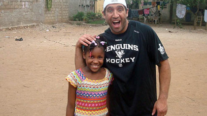 The Penguins&#039; Max Talbot shares a laugh with one of the children at the orphanage.