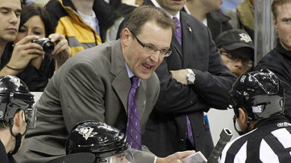 Penguins coach Dan Bylsma talks with referee Tim Peel in the third period.