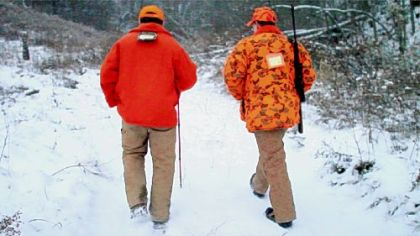 Father Mike Zavage, 28, right, hunts with his father, Mike Zavage, 55, of Carmichaels, Greene County, in Oak Forest, Greene County.