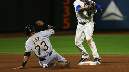 Mets second baseman Ruben Tejada completes a double play while the Pirates' Argenis Diaz unsuccessfully slides into second base in the eighth inning.