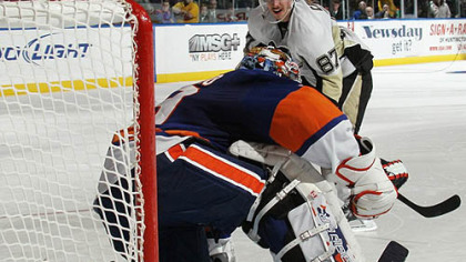 Penguins captain Sidney Crosby is stopped by Islanders goaltender Rick DiPietro on a shootout attept during Wednesday's game at Nassau Coliseum in Uniondale, New York.