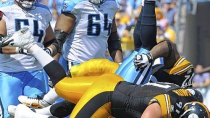 Steelers Aaron Smith stands Titans quarterback Vince Young on his head in a game earlier this season.