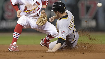 Alex Presley, pinch-running for the Pirates, steals second as St. Louis shortstop Brendan Ryan cannot handle the throw from catcher Matt Pagnozzi in the seventh inning.