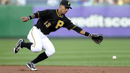 Pirates Ronny Cedeno can't come up with a ball hit by Mets Jose Reyes in the first inning.