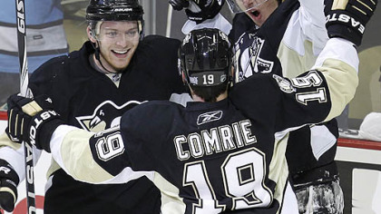 Penguins forward Evgeni Malkin, right, celebrates his first-period goal with teammates Mark Letestu and Mike Comrie.