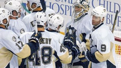 Marc-Andre Fleury is swarmed by his teammates after finishing the shutout of the Sabres.
