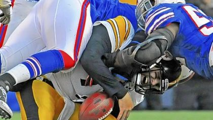 Ben Roethlisberger is sacked by the Bills' Arthur Moats Sunday at Ralph Wilson Stadium in Orchard Park, N.Y.
