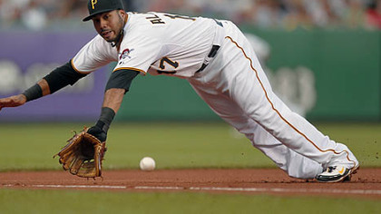 Third baseman Pedro Alvarez makes an outstanding diving stop to rob the Marlins' Cody Ross in the fourth inning Thursday at PNC Park. Alvarez threw Ross out from his knees.