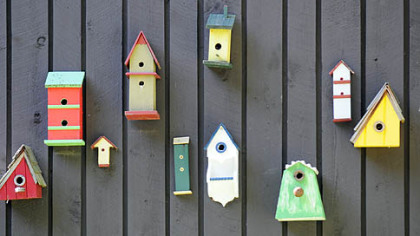 Hand-made birdhouses decorate Nada and Fred Sarkin&#039;s garden.