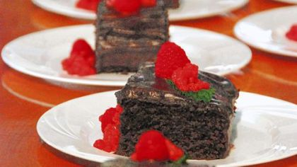 Vegan Chocolate Cake used no eggs or dairy products; the chocolate mint chantilly frosting is whipped chocolate and water with lecithin. The cake is garnished with agar-thickened raspberry &quot;pearls.&quot;