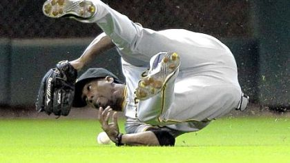 Pirates center fielder Andrew McCutchen tumbles while trying to catch a fly ball hit by the Astros' Jason Castro during the second inning yesterday's game in Houston. The Pirates lost 8-2.