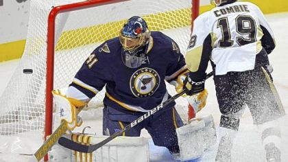 Blues goalie Jaroslav Halak made 31 saves Saturday night, including this one on Mike Comrie in the second period.