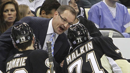 Penguins forwards Evgeni Malkin and Mike Comrie talk with coach Dan Bylsma in the first period.