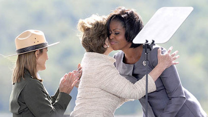 First Lady Michelle Obama and former First Lady Laura Bush embrace during the Flight 93 National Memorial ceremony in Shanksville today.