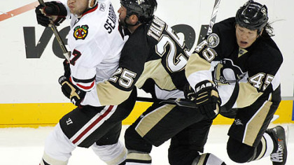 Penguins forward Arron Asham collides with teammate Max Talbot behind Blackhawks defenseman Brent Seabrook in the first period.