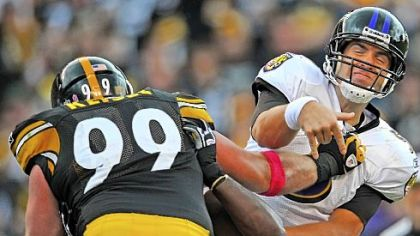 Brett Keisel, left, hitting Joe Flacco, wasn't happy with a big loss in the AFC North.