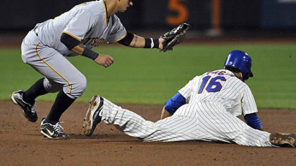 The Mets' Angel Pagan is caught trying to steal second base by Pirates shortstop Ronny Cedeno.