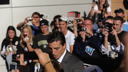 Penguins goaltender Marc-Andre Fleury arrive outside Consol Center prior to the game.