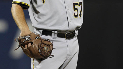 Pirates starting pitcher Zach Duke adjusts his hat after giving up a second-inning, two-run double to the Mets' Angel Pagan.