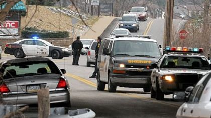 Police investigate the scene on Beatty Road in Monroeville where a 10-mile chase ended on Friday.