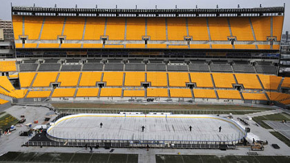 Workers prepare the ice rink at Heinz Field on Monday.