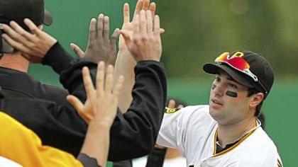 Neil Walker celebrates with teammates after the Pirates beat the Astros, 9-3, Sunday in the season finale at PNC Park.