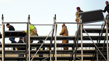 Workers erect temporary stands on Tuesday in the south end of Heinz Field for the Winter Classic.