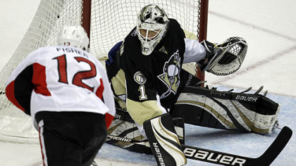 Penguins goaltender Brent Johnson blocks a shot by Senators forward Mike Fisher in the third period.
