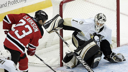 Penguins goaltender Brent Johnson makes a save on a shot by Devils forward David Clarkson during the second period.