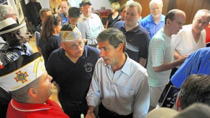 Democratic U.S. Senate candidate Joe Sestak, center, greets members of the crowd after speaking with a group of veterans at the Brentwood VFW on Clairton Boulevard on Monday.