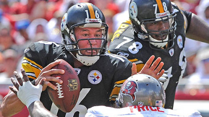 Charlie Batch breaks away from the grasp of the Buccaneers&#039; Brian Price at Raymond James Stadium Sunday with Max Starks (78) protecting his left side.
