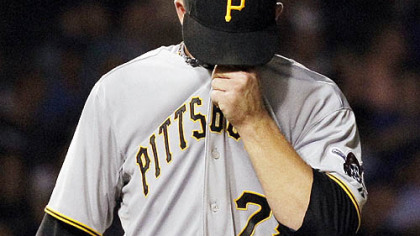 The Pirates&#039; Paul Maholm wipes his face while pitching in the second inning of the 14-2 loss Monday at Wrigley Field.
