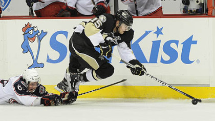 Penguins Dustin Jeffrey draws a tripping call on Columbus' Michael Ratchuk in the first period tonight.
