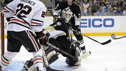 Penguins goaltender Brent Johnson makes a save against Blackhawks right wing Troy Brouwer during the first period.