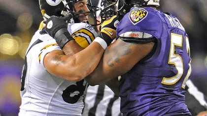 Hines Ward and Ray Lewis get tangled up in the first half.