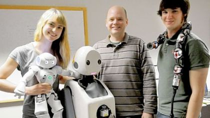 From left: CMU doctoral student Heather Knight with Little Toby, CMU Robotics Institute faculty member Paul E. Rybski with Snackbot and Robotics Institute lab assistant Austin Buchan with Uncle Sam.