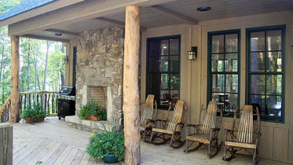 The Paddle House, a luxury rental  within the Wild Rock development on West Virginia's New River Gorge, has two covered porches, including one with an outdoor fireplace.