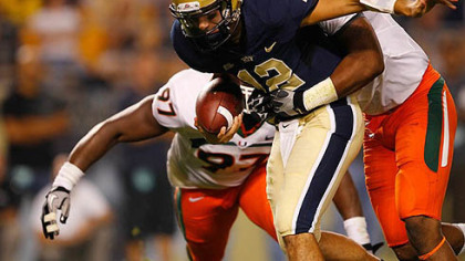 Pitt quarterback Tino Sunseri  is sacked by Andrew Smith of the Miami Hurricanes Thursday night at Heinz Field. Pitt lost 31-3.