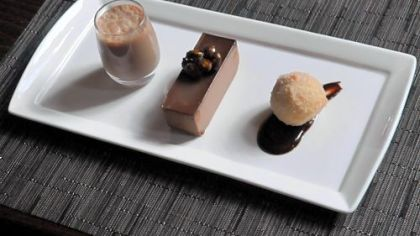 The sweets at Spoon include chocolate milk, chocolate mousse and a chocolate truffle beignet.