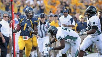 West Virginia's Tavon Austin runs down the sidelines for a first down against Coastal Carolina in the third quarter Saturday in Morgantown, W.Va.