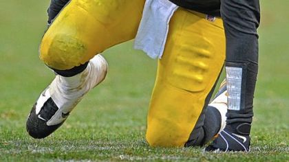 Steelers quarterback Ben Roethlisberger holds his ankle after being sacked by the Bengals at yesterday at Heinz Field.