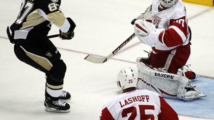 Penguins forward Sidney Crosby scores past Red Wings goaltender Chris Osgood during the first period.