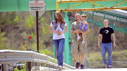 On April 7, two days after the fatal explosion, miner Brent Racer, center, walks with his daughter Alayah, 2,  his wife Tara and miner Patrick Lomas after they picked up their paychecks from the Upper Big Branch Mine.