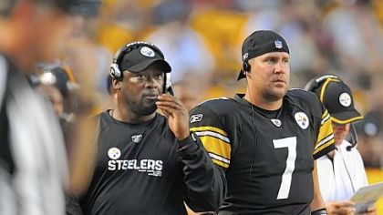 Ben Roethlisberger, right, spent the game on the sideline next to Mike Tomlin.