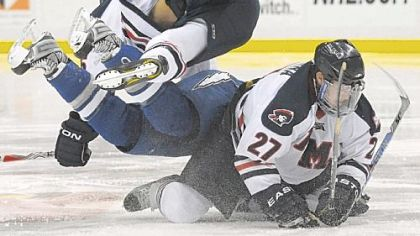 Robert Morris&#039; Brandon Blandina, bottom, collides with Scott Mathis, center and Furman South in Robert Morris&#039; victory Sunday against Air Force.